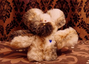 Hand-made teddy bear with heart nose